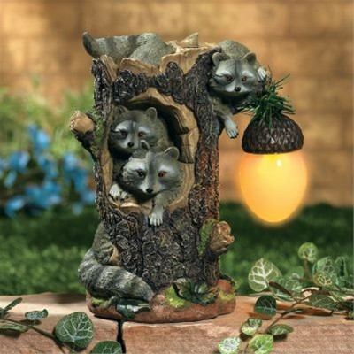 Raccoons Holding Solar Acorn Light. Solar Garden Lighting Decor